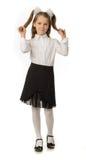 La muchacha de la cereza en un uniforme escolar Foto de archivo libre de regalías