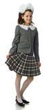 La muchacha de la cereza en un uniforme escolar Fotos de archivo