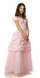 La muchacha de la cereza en una alineada de la rosa Foto de archivo
