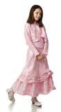 La muchacha de la cereza en una alineada de la rosa Imagenes de archivo