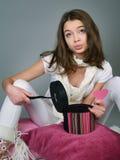 La muchacha de la decepción se sienta en las almohadillas Foto de archivo libre de regalías