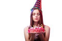 La muchacha de la mujer joven con la torta aislada en blanco Fotos de archivo