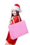 La muchacha de la Navidad de la belleza toma el bolso de compras en blanco rosado Imagen de archivo libre de regalías
