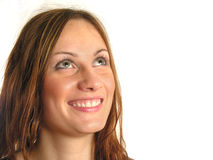 La muchacha de la sonrisa mira para arriba Imagen de archivo libre de regalías