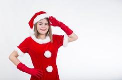 La muchacha de la Navidad dice hola Foto de archivo