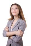 La muchacha de pelo largo en una chaqueta gris Fotografía de archivo