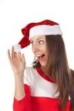 La muchacha de risa en un sombrero de la Navidad y un vestido rojo Imagenes de archivo