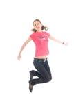 La muchacha de salto joven aislada en un blanco Imagen de archivo libre de regalías