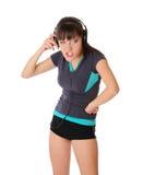 La muchacha del adolescente es escucha música en los auriculares Fotos de archivo libres de regalías