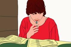 La muchacha del estudiante leída aprende imagen de archivo libre de regalías