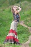 La muchacha del hippie en la lluvia Fotos de archivo libres de regalías