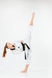 La muchacha del karate con la correa negra Foto de archivo