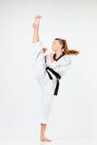 La muchacha del karate con la correa negra Fotos de archivo libres de regalías