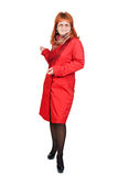 La muchacha del redhead en rojo Imágenes de archivo libres de regalías