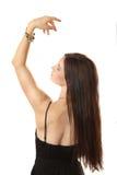 La muchacha delgada de una parte posterior mira una pulsera Imagenes de archivo
