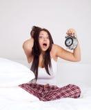 La muchacha despierta tarde Imagen de archivo libre de regalías