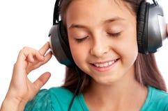 La muchacha disfruta de la música Imagen de archivo libre de regalías