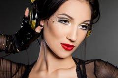 La muchacha DJ escucha música Foto de archivo libre de regalías