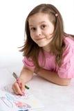 La muchacha drena fotografía de archivo libre de regalías