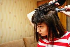 La muchacha el cabello seco Fotos de archivo
