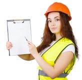 La muchacha el constructor en un casco   Foto de archivo libre de regalías