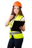 La muchacha el constructor en un casco   Fotos de archivo libres de regalías