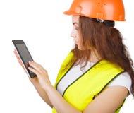 La muchacha el constructor en un casco   Fotografía de archivo libre de regalías