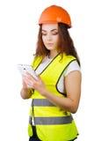 La muchacha el constructor en un casco   Imagenes de archivo