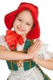 La muchacha - el pequeño capo motor de montar a caballo rojo. Foto de archivo libre de regalías