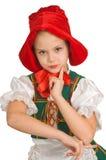 La muchacha - el pequeño capo motor de montar a caballo rojo. Fotografía de archivo