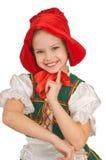 La muchacha - el pequeño capo motor de montar a caballo rojo. Fotografía de archivo libre de regalías
