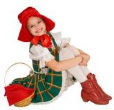 La muchacha - el pequeño capo motor de montar a caballo rojo. Imagenes de archivo