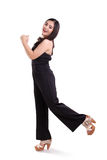 La muchacha elegante salta de felicidad Imagenes de archivo