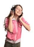 La muchacha en auriculares Foto de archivo libre de regalías