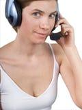 La muchacha en auriculares Imagen de archivo libre de regalías
