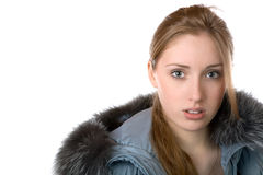 La muchacha en chaqueta caliente con un capo motor aislado Imágenes de archivo libres de regalías