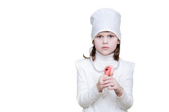 La muchacha en doctor viste con un estetoscopio y una Cruz Roja en el sombrero Fotografía de archivo libre de regalías