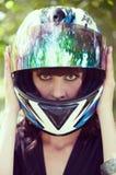 La muchacha en el casco de la motocicleta Imagen de archivo libre de regalías