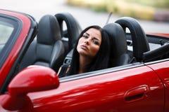 La muchacha en el coche Fotos de archivo