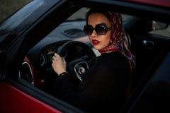 La muchacha en el coche Imagen de archivo libre de regalías