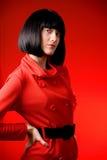 La muchacha en el rojo Imágenes de archivo libres de regalías