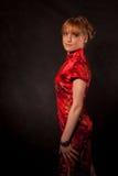 La muchacha en el rojo Foto de archivo