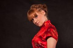 La muchacha en el rojo Fotografía de archivo