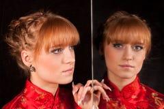 La muchacha en el rojo Imagenes de archivo