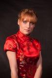 La muchacha en el rojo Imagen de archivo