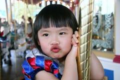 La muchacha en feliz va redondo Imágenes de archivo libres de regalías