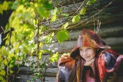 La muchacha en hojas de la uva Fotos de archivo
