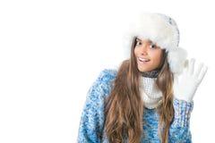 La muchacha en invierno viste en un fondo blanco Fotografía de archivo libre de regalías