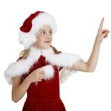 La muchacha en la Navidad arropa puntas un dedo Fotografía de archivo libre de regalías