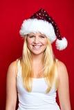 La muchacha en la Navidad está sonriendo Imagenes de archivo